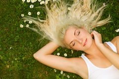 Woman relaxing on a meadow Stock Photos