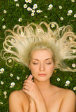 Woman relaxing on a meadow Royalty Free Stock Photography