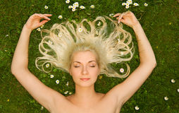 Woman relaxing on a meadow Royalty Free Stock Image