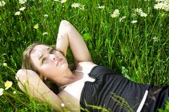Woman relaxing in meadow Royalty Free Stock Photo