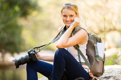 Woman relaxing mountain. Happy young woman relaxing in mountain valley Stock Image