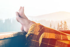 Woman relaxing in mountains royalty free stock photo