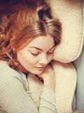 Woman relaxing napping in bed under wool blanket. Stock Images