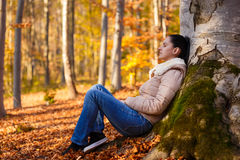 Woman relaxing in nature while autumn season Royalty Free Stock Images