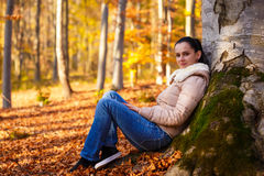 Woman relaxing in nature while autumn season Royalty Free Stock Photos
