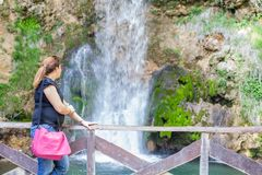 Woman Relaxing Nature Waterfall Stock Image