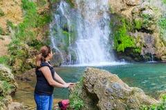 Woman Relaxing Nature Waterfall Stock Photo