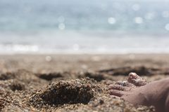Woman relaxing near beach with barefoot on the sand with glowing Royalty Free Stock Images