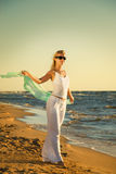 Woman relaxing near the ocean Stock Photography
