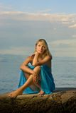 Woman relaxing near the sea Royalty Free Stock Photography