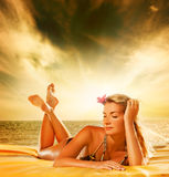 Woman relaxing near the sea Royalty Free Stock Images