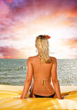Woman relaxing near the sea Royalty Free Stock Photos