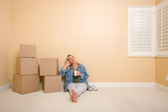 Woman Relaxing Next to Boxes on Floor with Cup Royalty Free Stock Photos