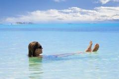 Woman Relaxing in the Ocean stock photos