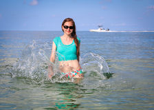 Woman Relaxing in Ocean royalty free stock images