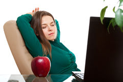 Woman relaxing in the office Stock Image