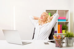 Woman relaxing at the office Stock Photo