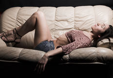 Woman Relaxing On A Sofa Stock Photo