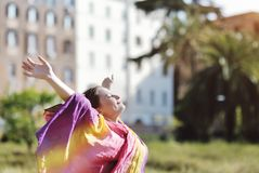 Woman relaxing with open arms and face to sun Royalty Free Stock Images