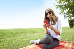 Woman relaxing outdoor Stock Photo