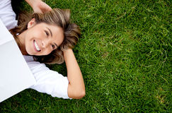 Woman relaxing outdoors Royalty Free Stock Image