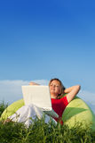 Woman relaxing outdoors Royalty Free Stock Photo
