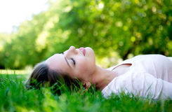 Woman relaxing outdoors Stock Photography