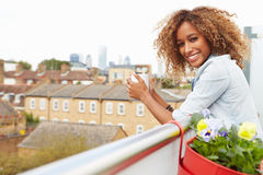 Woman Relaxing Outdoors On Rooftop Garden Stock Photo