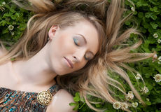 Woman relaxing outdoors smiling Stock Image