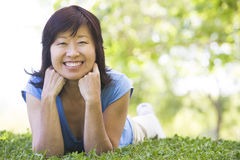 Woman relaxing outdoors smiling Stock Photo