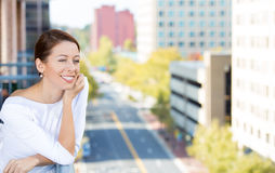 Woman relaxing on outside balcony Stock Photography