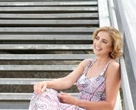 Woman relaxing outside with happy expression Stock Photos
