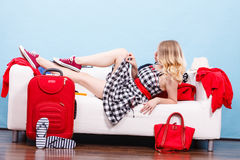 Woman relaxing after packing suitcase for vacation Royalty Free Stock Image