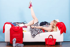 Woman relaxing after packing suitcase for vacation Stock Photography