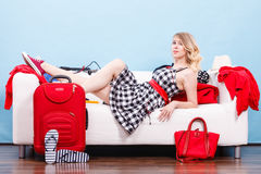Woman relaxing after packing suitcase for vacation Royalty Free Stock Photography