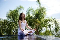 Woman relaxing in a paradise sea view Stock Photography