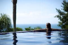 Woman relaxing in a paradise sea view Stock Photos