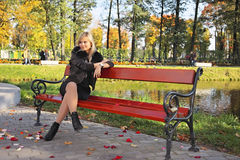 Woman relaxing in the park Royalty Free Stock Photo
