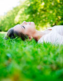 Woman relaxing at the park Royalty Free Stock Image