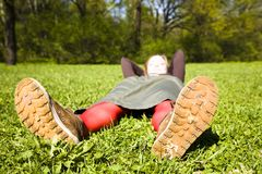 Woman relaxing in park Stock Photos