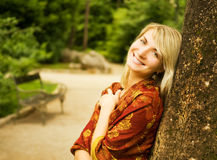 Woman relaxing in a park Royalty Free Stock Photo