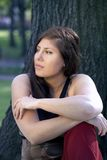 Woman relaxing in park Stock Photography