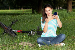 Woman relaxing in the park on the lawn Stock Images