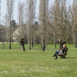 A woman relaxing in the park Stock Image