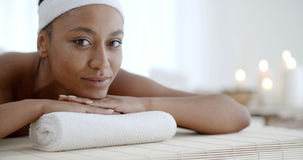 Woman Relaxing On A Pillow Royalty Free Stock Photos