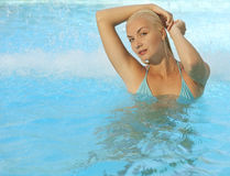 Woman relaxing in the pool Stock Photography