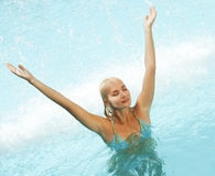 Woman relaxing in the pool Stock Images