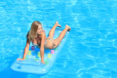 Woman Relaxing in a pool Royalty Free Stock Photos