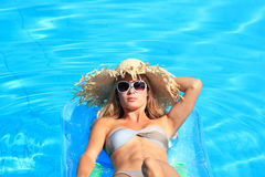 Woman Relaxing in a pool Stock Image