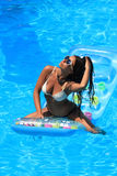 Woman Relaxing in a pool Royalty Free Stock Photography